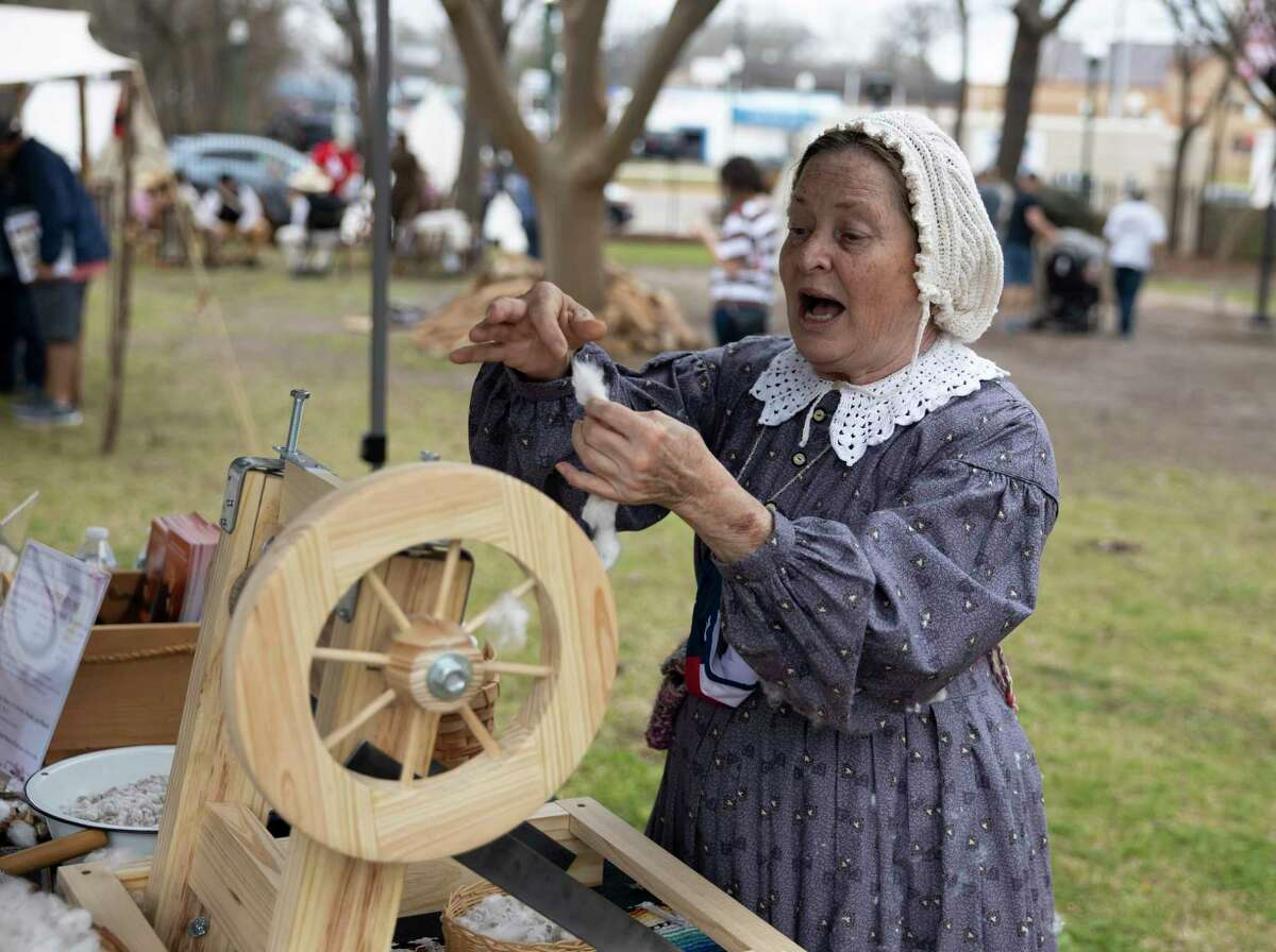 Jude Routh, with the Sam Houston Memorial Museum, demonstrates how to process cotton into yarn during the Texas Independence Celebration at Heritage Park, Saturday in Conroe.