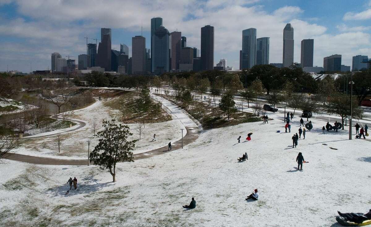 People sled at Buffalo Bayou Park on Feb. 15.
