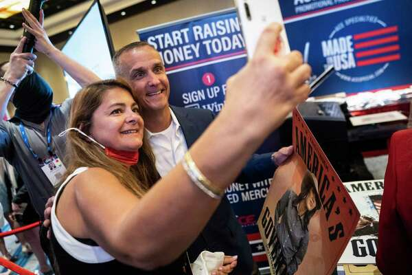 Corey Lewandowski, a former campaign manager for Donald Trump, holds a poster of South Dakota Gov. Kristi Noem, a Republican, at the Conservative Political Action Conference in Orlando, Fla., on Saturday.