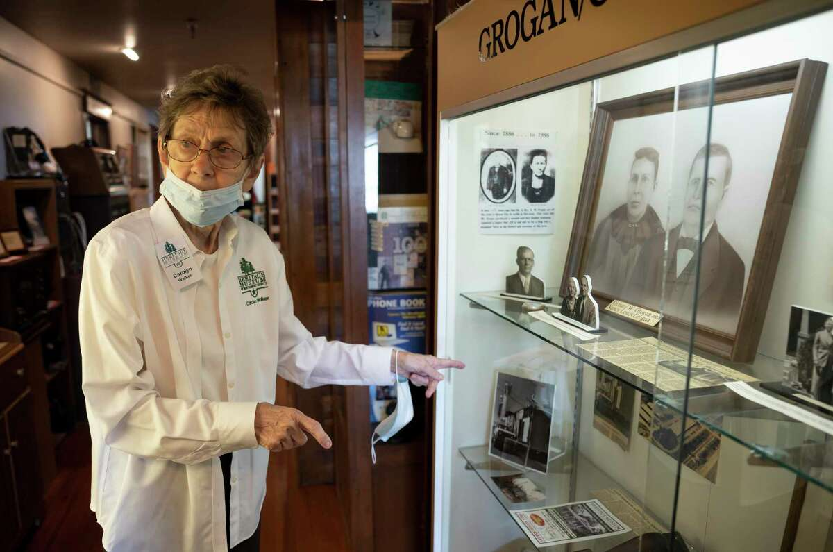 Carolyn Walker describes the artifacts inside a glass case at the Heritage Museum of Montgomery County in Conroe, Saturday, Nov. 14, 2020. With the reopening of the museum they've added three new exhibits. The museum sustained damage during the winter storm, but no artifacts were damaged.