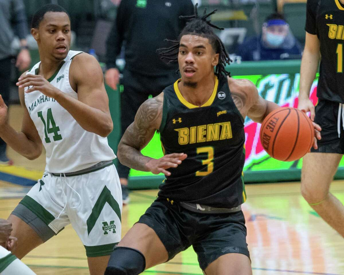 Siena College senior Manny Camper drives the lane in front of Manhattan College junior Marquis Watson during a Metro Atlantic Athletic Conference game at the UHY Center on the Siena campus in Loudonville, NY, on Saturday, Feb. 27, 2021 (Jim Franco/special to the Times Union.)