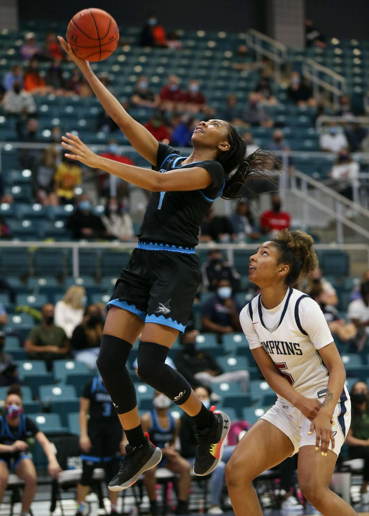 Shadow Creek Sharks guard Brooklin Brown (1) lays up the ball over Tompkins Crystal Smith (5) during the regional semi-finals at Merrell Center in Katy on Saturday, Feb. 27, 2021. Shadow Creek won the game.