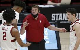Stanford coach Jerod Haase, center, speaks to guard Bryce Wills (2) during the second half of an NCAA college basketball game against Oregon State in Stanford, Calif., Saturday, Feb. 27, 2021. (AP Photo/Josie Lepe)