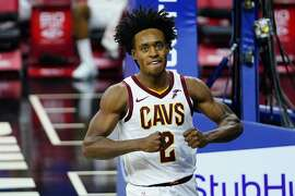 Cleveland Cavaliers' Collin Sexton reacts after a basket during the first half of an NBA basketball game against the Philadelphia 76ers, Saturday, Feb. 27, 2021, in Philadelphia. (AP Photo/Matt Slocum)