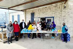 Members of a food distribution program in El Cenizo are pictured after a recent food drive during the power outages.