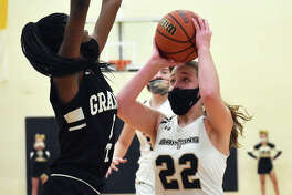 Father McGivney's Charlize Luehmann scored a game-high 18 points in her team's win over Christ Our Rock Lutheran on Saturday.
