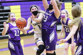 CM's Tori Standefer, shown putting up a shot around Breese Central's Maggie Schrage (33) in a Feb. 9 game in Bethalto, on Saturday scored a career-high 23 points in the Eagles' win ove Cahokia.
