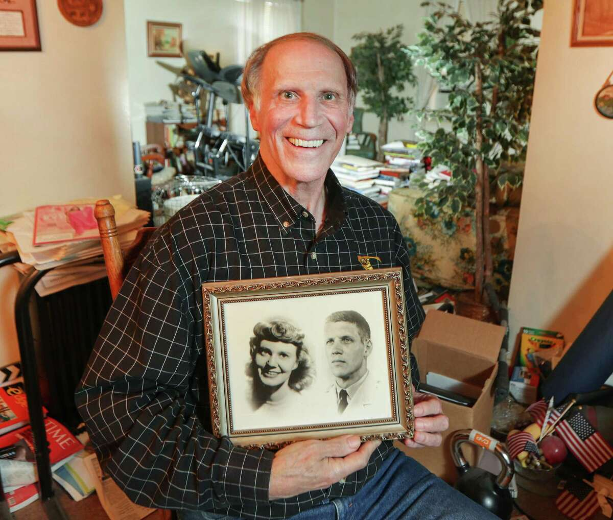 Houston Chronicle reader Bill Pond holds a photo of his parents, Minnie and Bill, in the home he has lived in since he was a child Friday, Feb. 26, 2021, in Humble. Pond said that during the frigid cold he could hear the beams expand and creak.