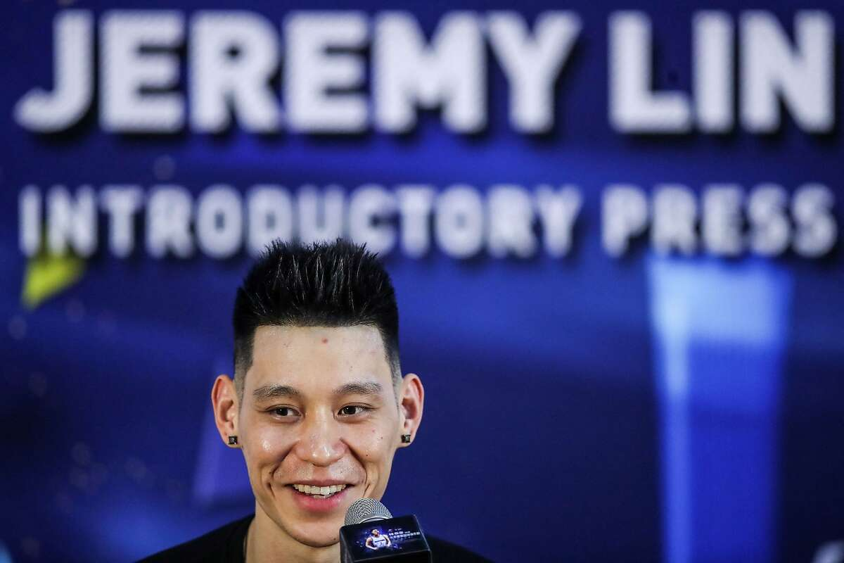 """(FILES) In this file photo taken on September 26, 2019, former NBA player Jeremy Lin of the US speaks during an introductory press conference held by his new team Beijing Shougang in Beijing. - Lin said on February 27, 2021, he won't be """"naming or shaming anyone"""" amid reports the NBA's G League is investigating his claim he was called """"coronavirus"""" during a game. (Photo by STR / AFP) / China OUT (Photo by STR/AFP via Getty Images)"""