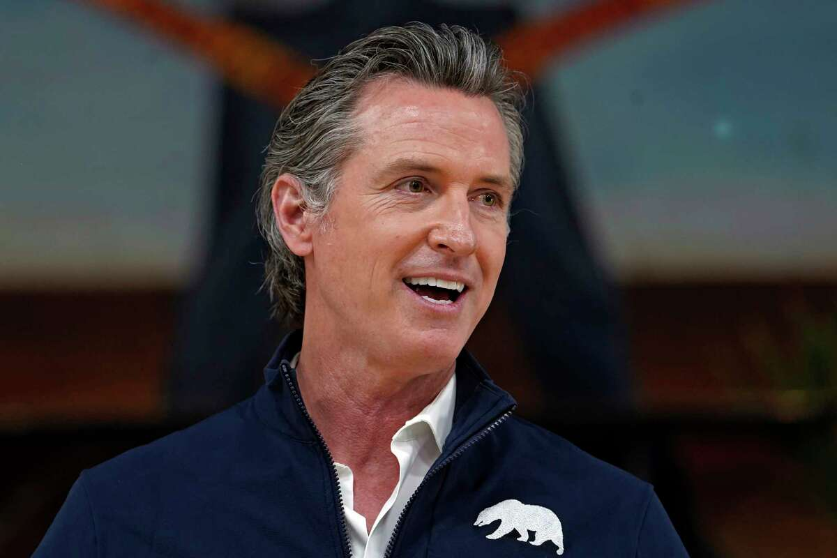 FILE - In this Feb. 21, 2021, file photo, California Gov. Gavin Newsom takes questions from the media during a visit to a mobile vaccination site at Ramona Gardens Recreation Center in Los Angeles.