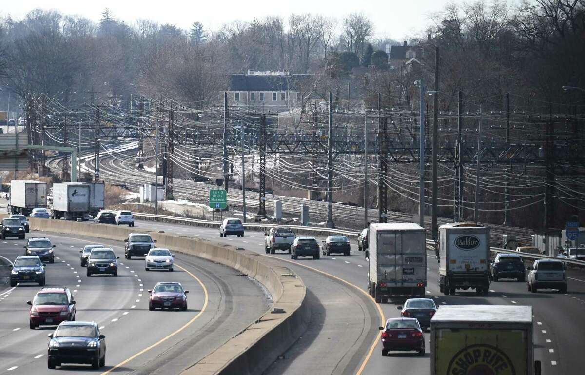 Trees and brush that used to separate I-95 from the train tracks are now clear as traffic approaches Exit 3 in Greenwich, Conn. Tuesday, Feb. 16, 2021. Many residents have been complaining about the cutting of trees along the highways and train tracks.