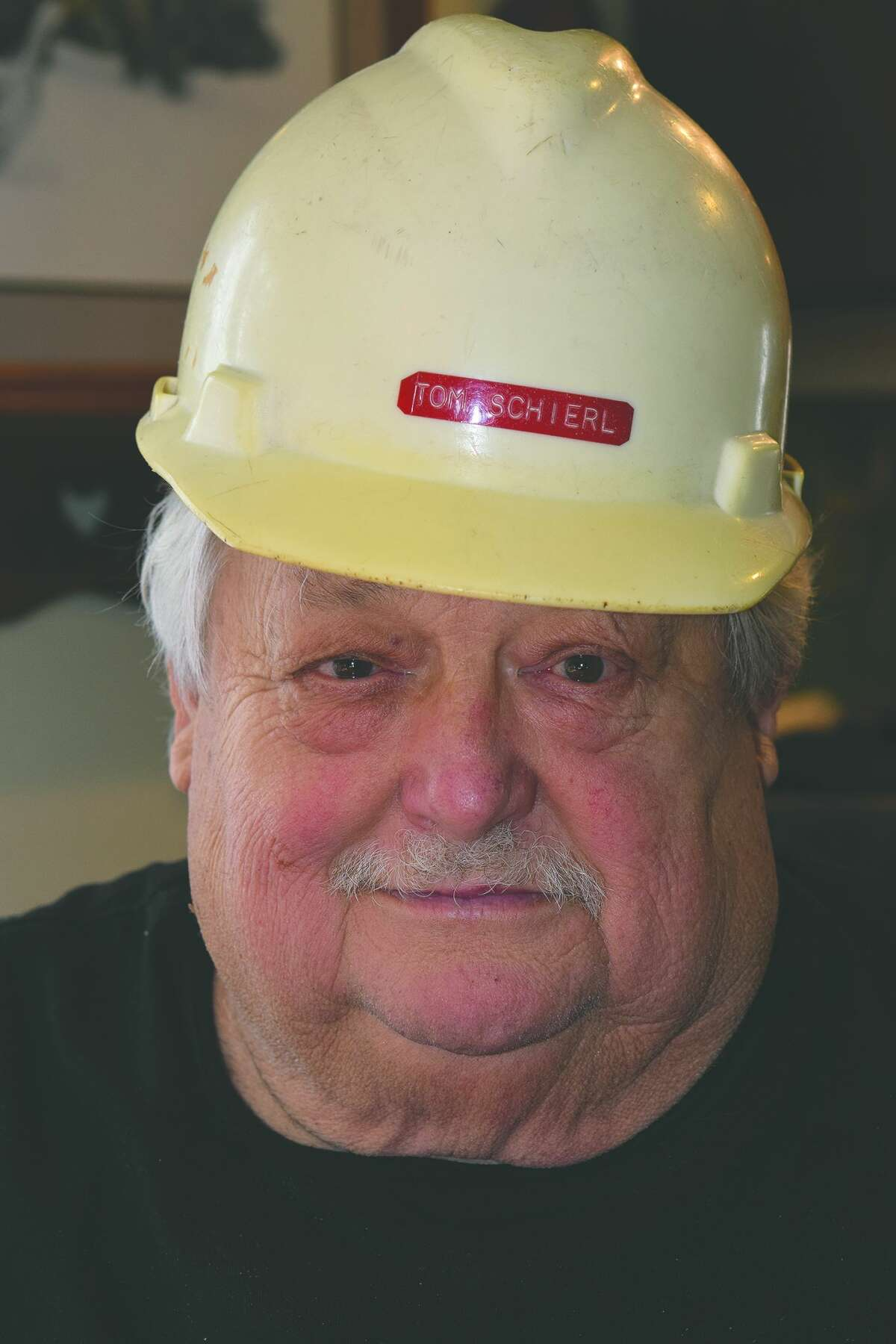Tom Schierl and the hardhat he wore as engineering manager at the Carnation/Nestle plant.