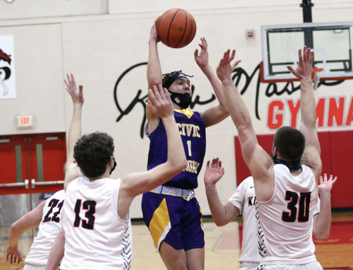 CM's Trey Hall (1) passes out of a quadruple team against Triad in a Feb. 23 Mississippi Valley Conference boys basketball game in Troy. On Saturday in Bethalto, the Eagles picked up their first win of the season by beating EA-WR.