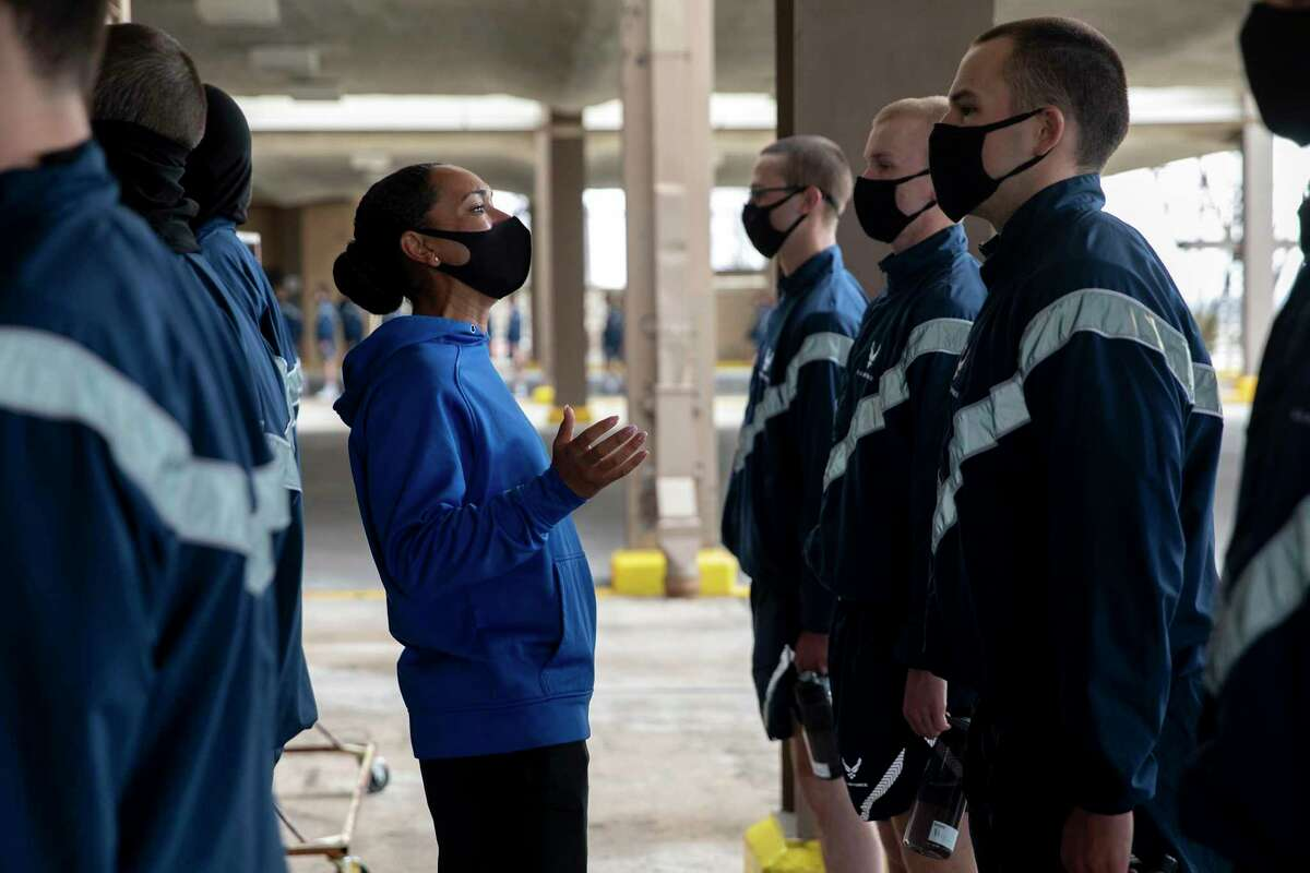 Tech Sgt. Mikesha Jones scolds her flight of trainees at Joint Base San Antonio-Lackland because they did not get their laundry done before physical training.