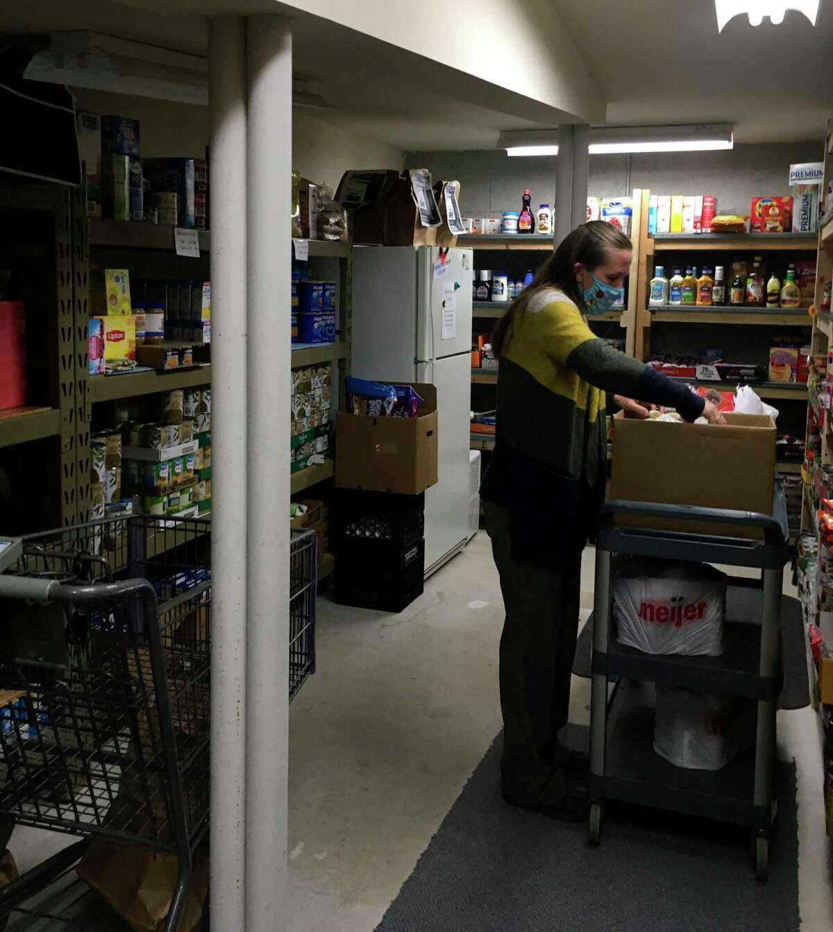 Shari O'Neal, ECHO His Love ministry resource director, works in the MANNA Food Pantry. (Courtesy photo)