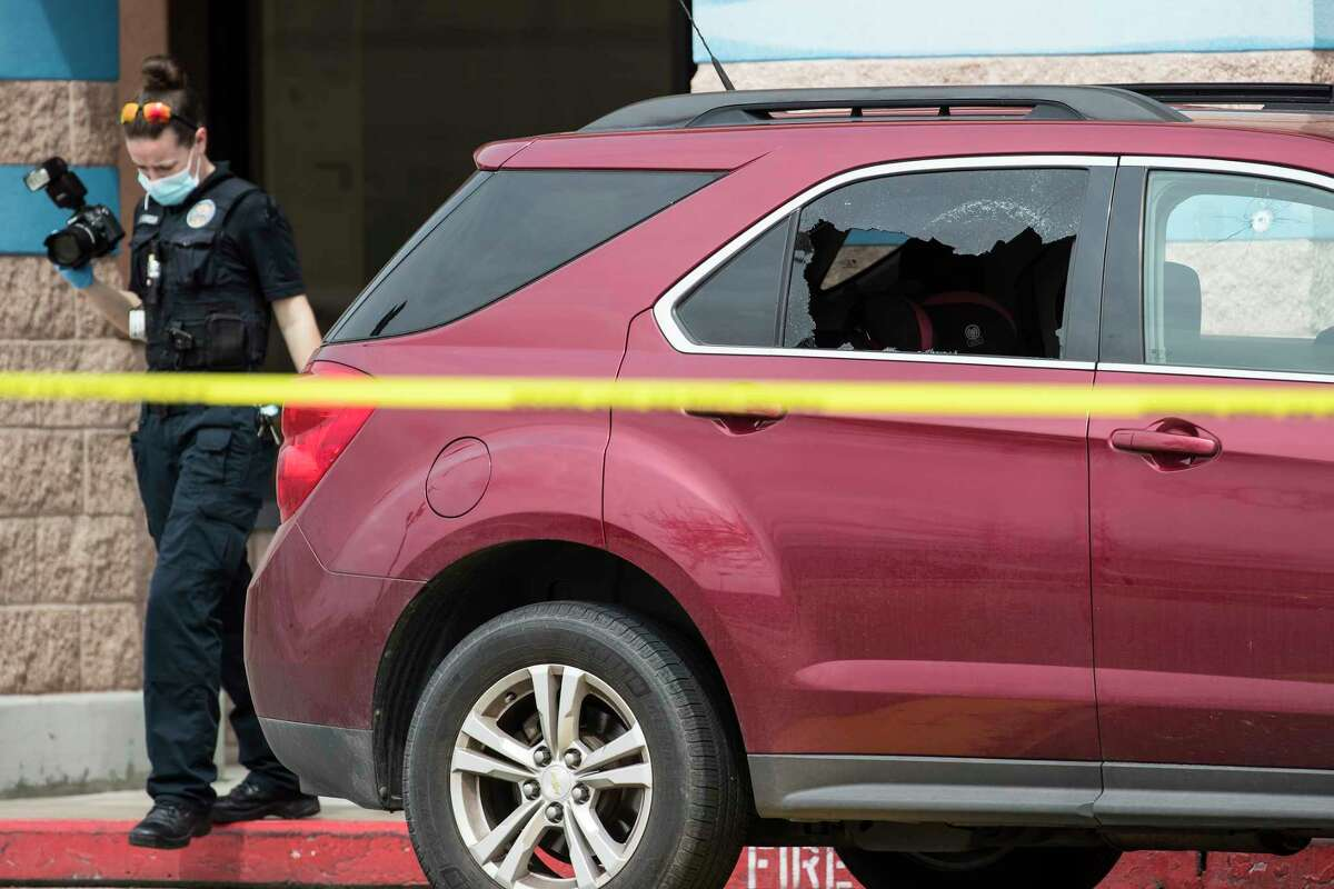 Police investigate the scene of a shooting that injured at least four people at a shopping strip center in the 13000 block of the Northwest Freeway Sunday, Feb. 28, 2021 in Houston.