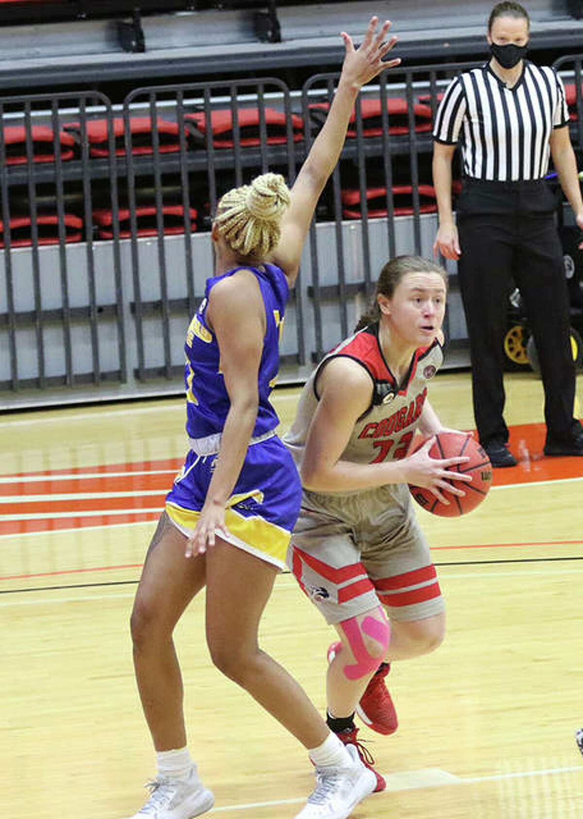 SIUE's Allie Troeckler drives around a Morehead State defender left out of position by a head fake during a Jan. 16 game at First Community Arena. Troeckler, a senior from Bethalto, saw her college career come to a close with Saturday's home loss to Southeast Missouri.
