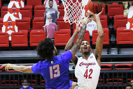 SIUE's Shamar Wright (42), shown scoring over Tennessee State's Mason Green during a Feb. 4 home game, was back at First Community Arena on Saturday and scored 11 points in the Cougars' OVC loss to Southeast Missouri.