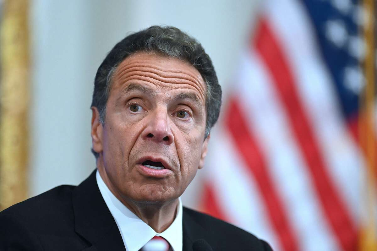 (FILES) In this file photo Governor of New York Andrew Cuomo speaks during a press conference at the New York Stock Exchange (NYSE) on May 26, 2020 at Wall Street in New York City. - Prominent Democratic politicians called on February 28, 2021 for an independent investigation into sexual harassment allegations against New York governor Andrew Cuomo after a second former aide accused him of misconduct. The latest allegations were made public on Saturday after 25-year-old former health advisor Charlotte Bennett told The New York Times the governor sexually harassed her in 2020. (Photo by Johannes EISELE / AFP) (Photo by JOHANNES EISELE/AFP via Getty Images)