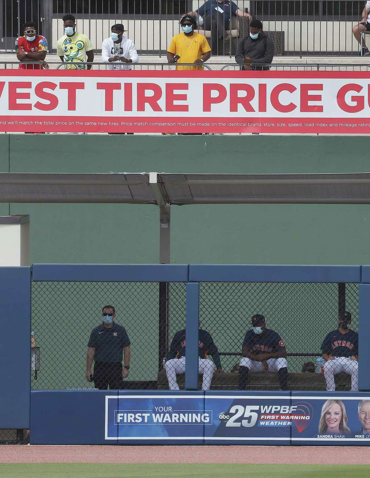 Houston Astros pitcher Framber Valdez (59) and other Astros pitchers stand in street clothes above the Astros bullpen during the first inning of an MLB spring training game at Ballpark of the Palm Beaches in West Palm Beach, Florida, Sunday, February 28, 2021.