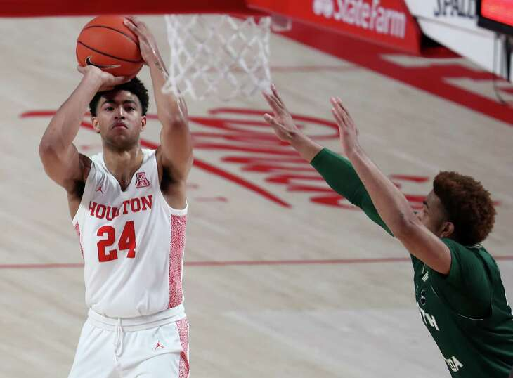 Houston guard Quentin Grimes (24) takes a shot against South Florida guard David Collins during the first half on an NCAA basketball game Sunday, Feb. 28, 2021, at Fertitta Center in Houston.