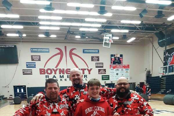 Sam Ross and his Benzie Central coaches celebrate his 100th career victory. (Submitted photo/Sarah Ross)