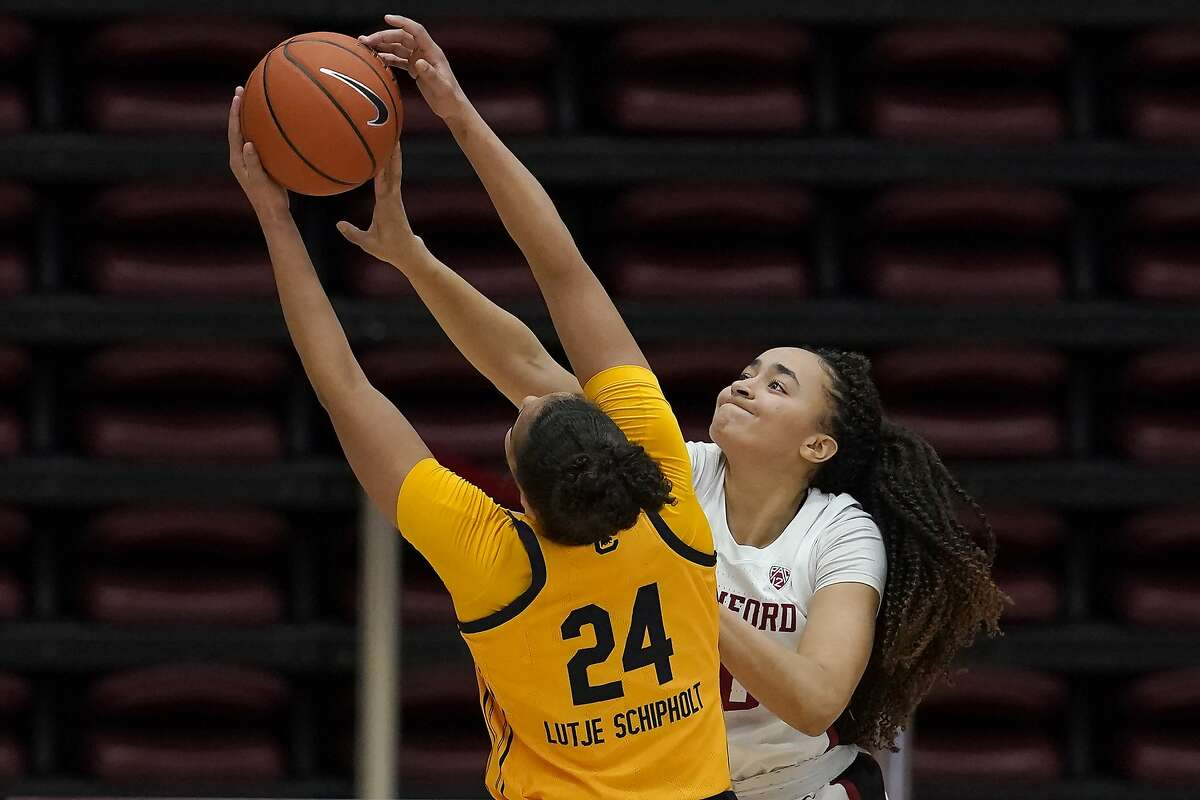 California forward Evelien Lutje Schipholt, left, is defended by Stanford guard Haley Jones, right, during the first half of an NCAA college basketball game in Stanford, Calif., Sunday, Feb. 28, 2021. (AP Photo/Jeff Chiu)