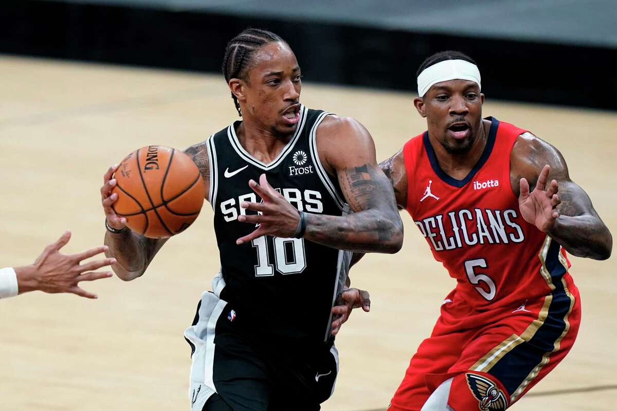 San Antonio Spurs forward DeMar DeRozan (10) drives to the basket past New Orleans Pelicans guard Eric Bledsoe (5) during the first half of an NBA basketball game in San Antonio, Saturday, Feb. 27, 2021. (AP Photo/Eric Gay)