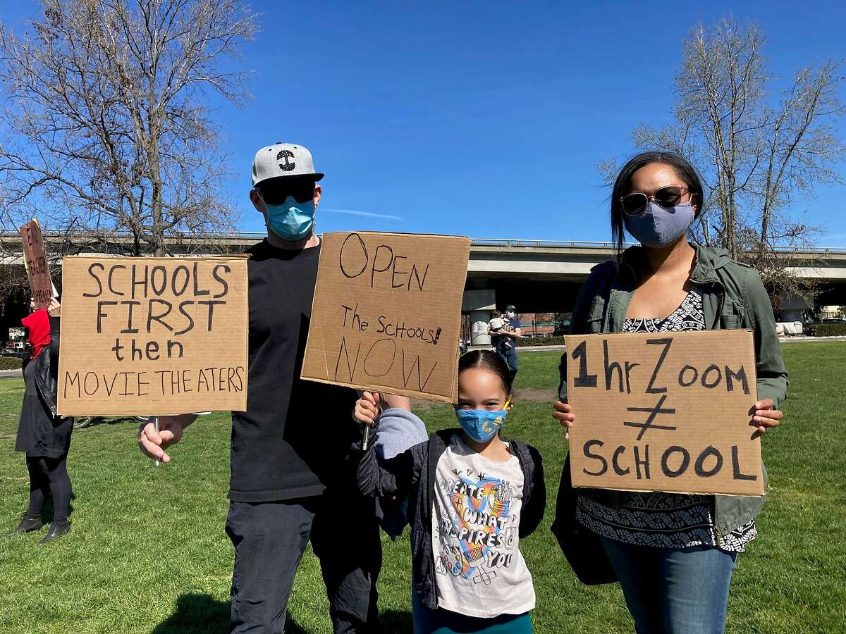 One of the Oakland families pushing for schools to reopen at a rally on Sunday.