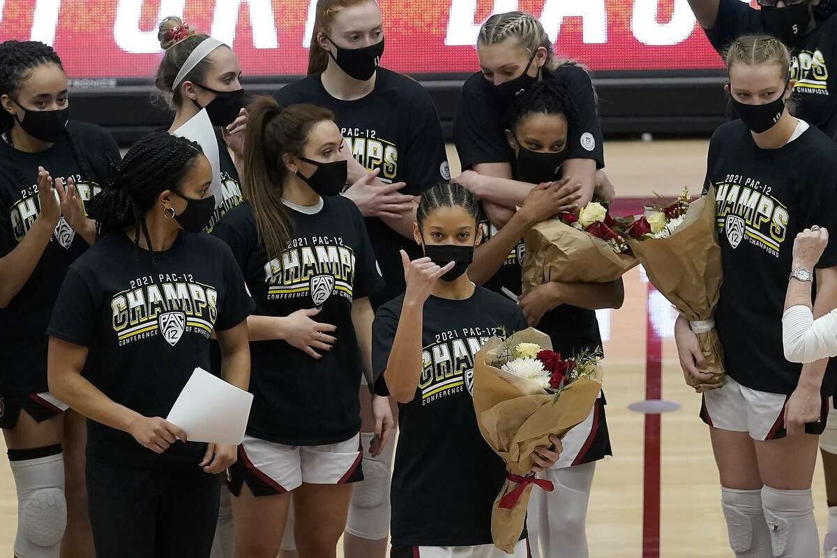 Stanford guard Anna Wilson, foreground, gestures in front of teammates as she and other senior players are honored after Stanford defeated California in an NCAA college basketball game in Stanford, Calif., Sunday, Feb. 28, 2021. (AP Photo/Jeff Chiu)