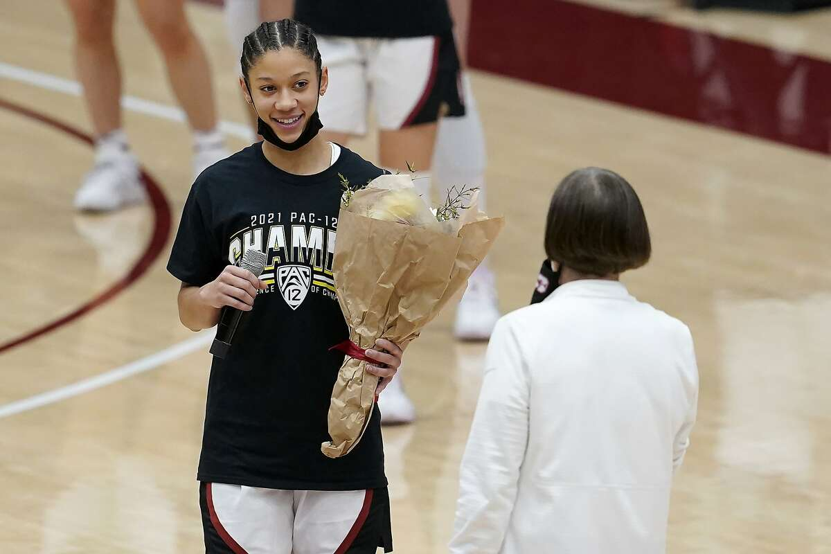 Stanford guard Anna Wilson, left, listens to head coach Tara VanDerveer speak as she and other senior players are honored after Stanford defeated California in an NCAA college basketball game in Stanford, Calif., Sunday, Feb. 28, 2021. (AP Photo/Jeff Chiu)