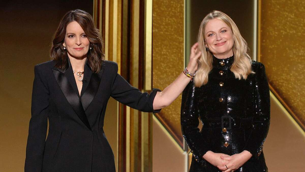 This handout screen grab courtesy of NBCUniversal shows hosts, Tina Fey (L) and Amy Poehler (R) during the 78th Annual Golden Globe Awards.