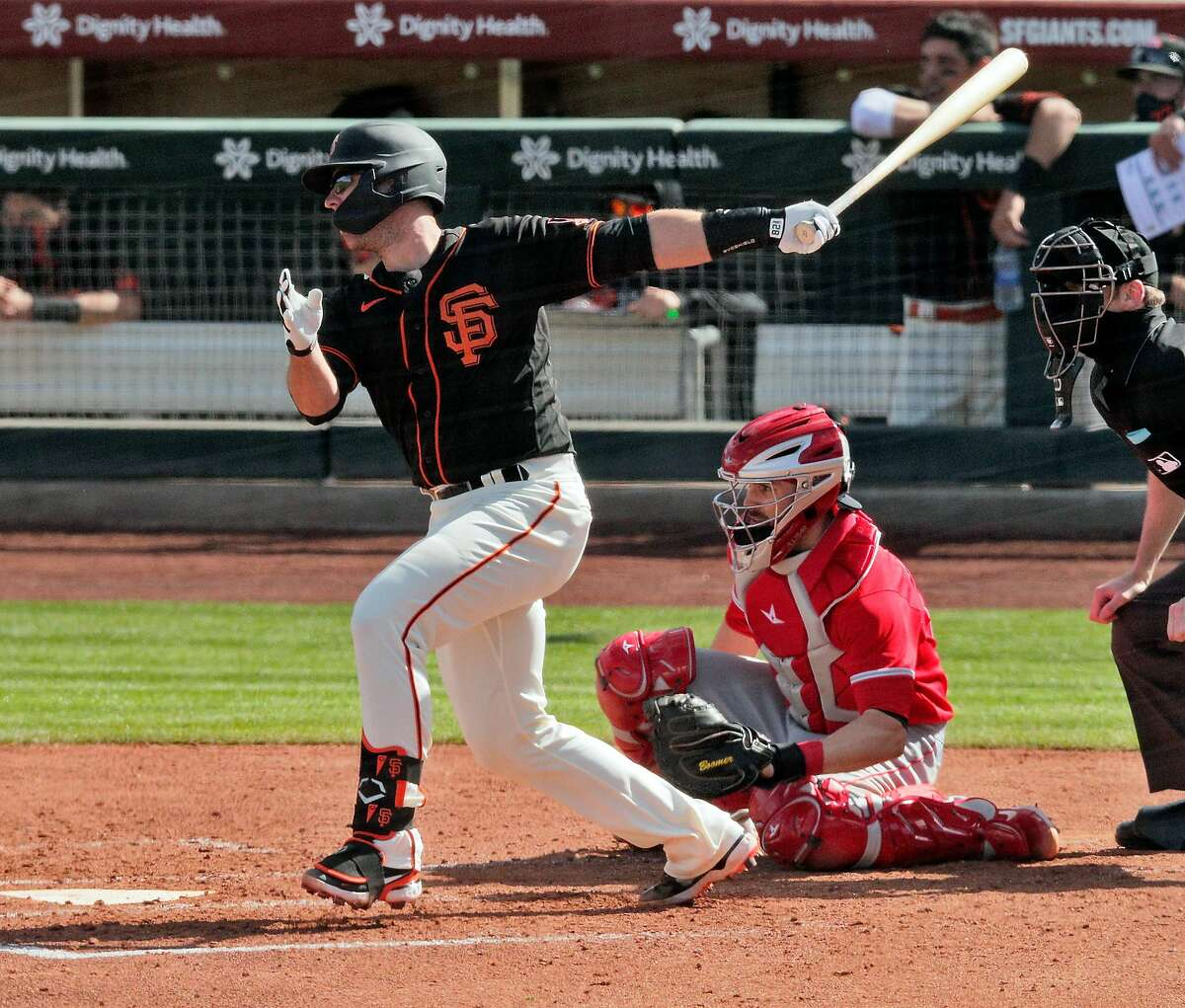 Buster Posey, who sat out last season, returned to the lineup and got the Giants' first hit of the spring with a single to right.