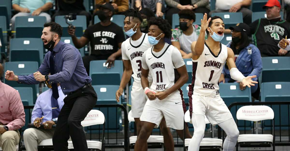 Summer Creek's bench reacts to the team's run during regional quarterfinals playoff game against Shadow Creek at Merrell Center in Katy on Saturday, Feb. 27, 2021. Summer Creek won the game.