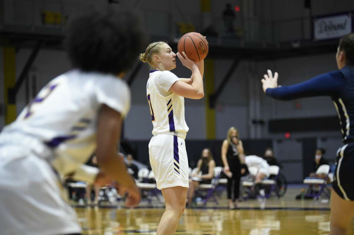 UAlbany forward Ellen Hahne gets to launch a shot against New Hampshire in an America East women's basketball tournament quarterfinal game Sunday, Feb. 28, 2021, at SEFCU Arena in Albany. UAlbany advanced to the semifinals with a 49-43 victory. (Kathleen Helman/UAlbany athletics)