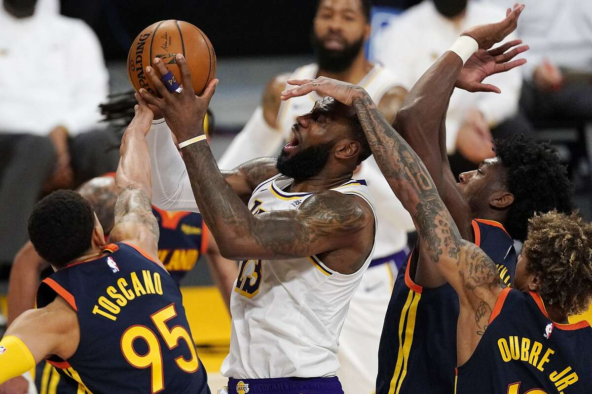 LeBron James, who spent a lot of time on the bench thanks to L.A.'s big lead, is fouled by the Warriors on a drive.