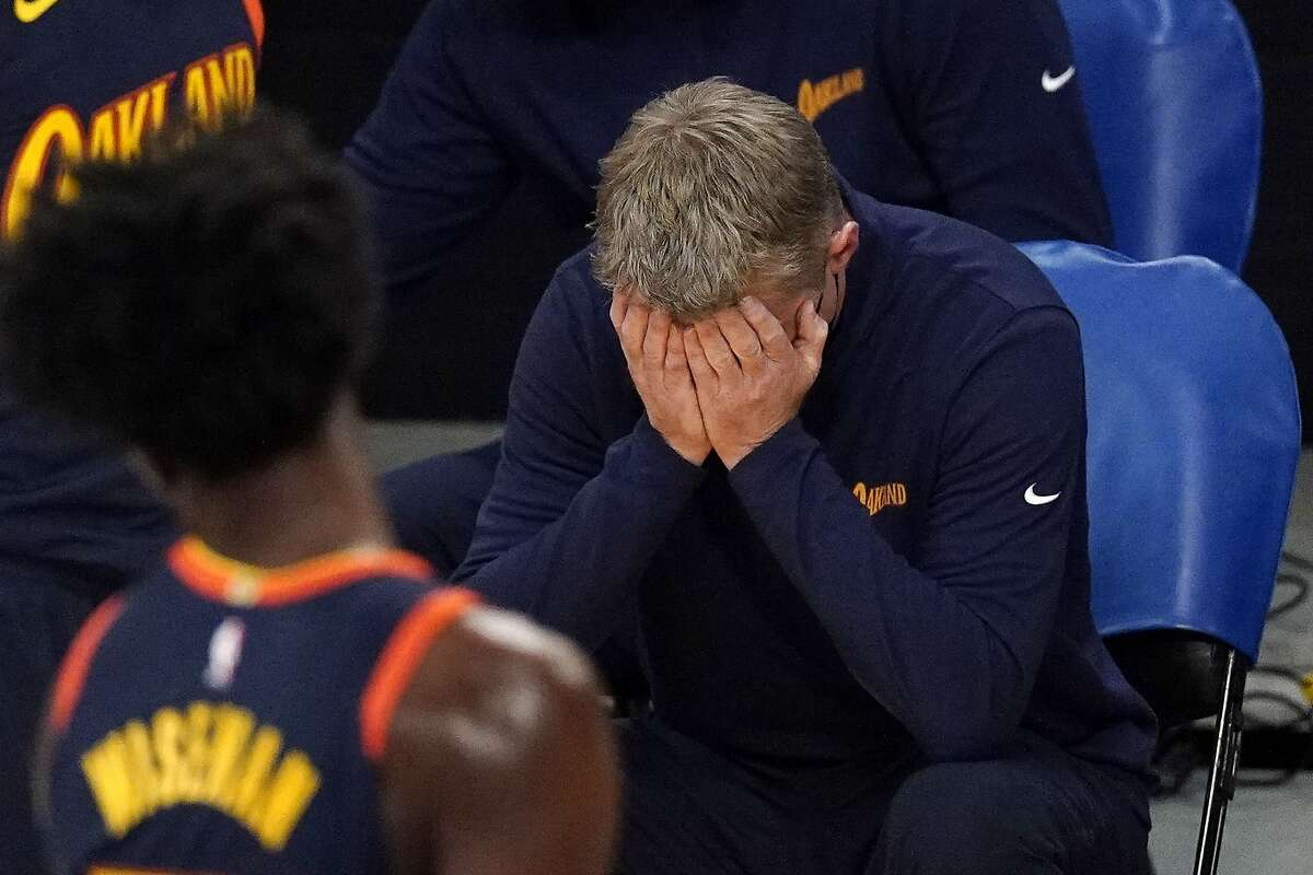Warriors head coach Steve Kerr can only put his head in his hands after his team was charged with an offensive foul.