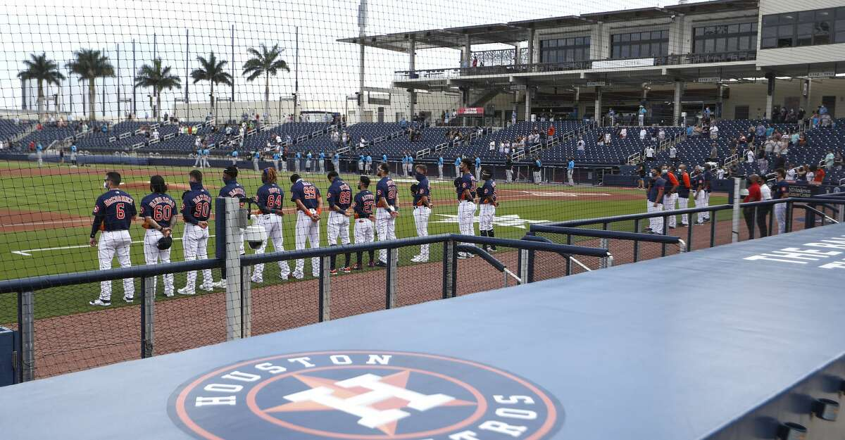 Houston Astros line up for the National Anthem before the start of an MLB spring training game at Ballpark of the Palm Beaches in West Palm Beach, Florida, Sunday, February 28, 2021.