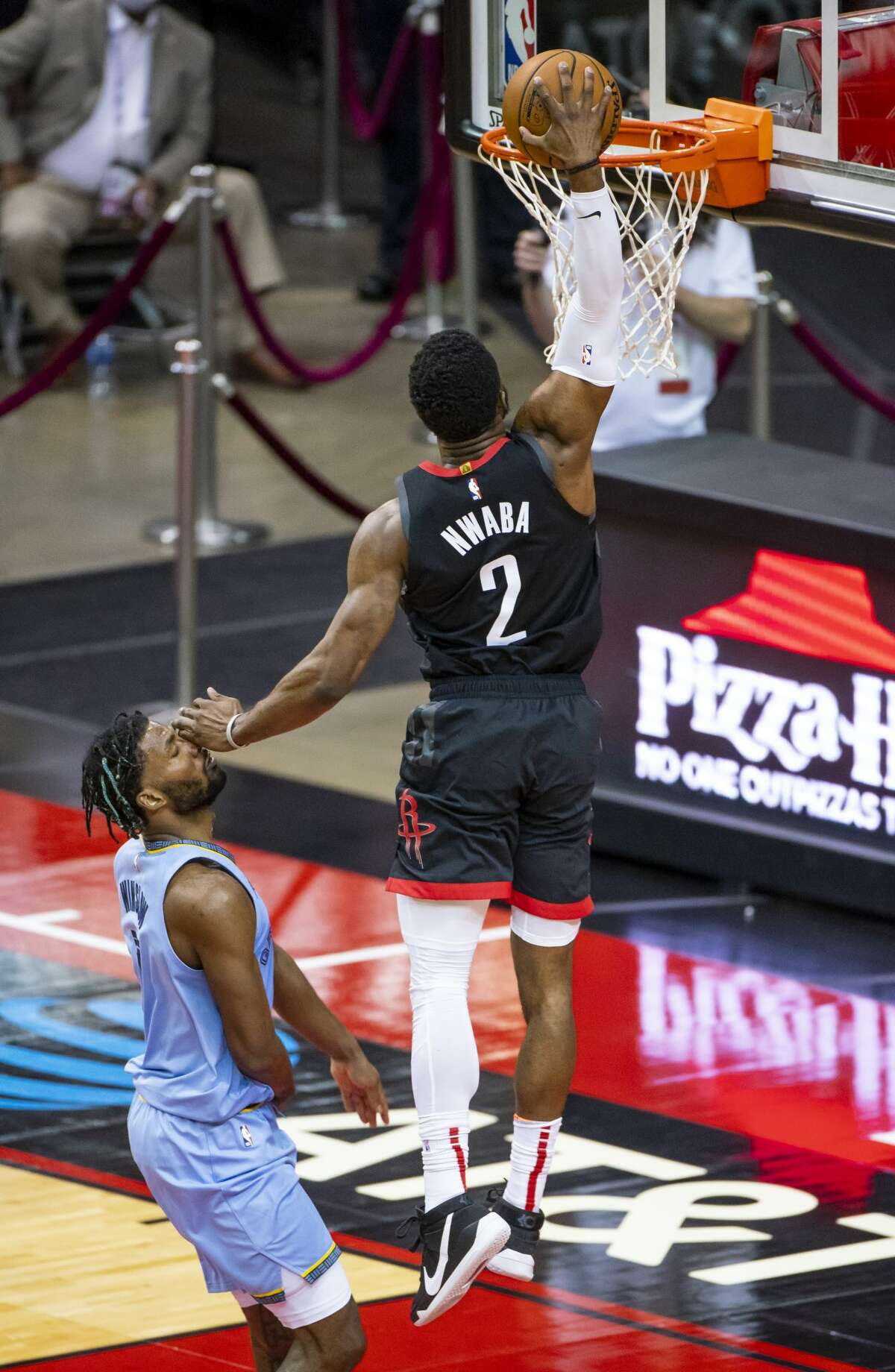 Houston Rockets guard David Nwaba (2) dunks over Memphis Grizzlies forward Justise Winslow (7) during the third quarter of an NBA basketball game between the Houston Rockets and Memphis Grizzlies on Sunday, Feb. 28, 2021, at Toyota Center in Houston.