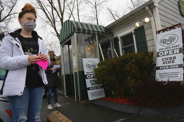 Dallas Rockne of Darien waits to pick up some desserts at Rory's.