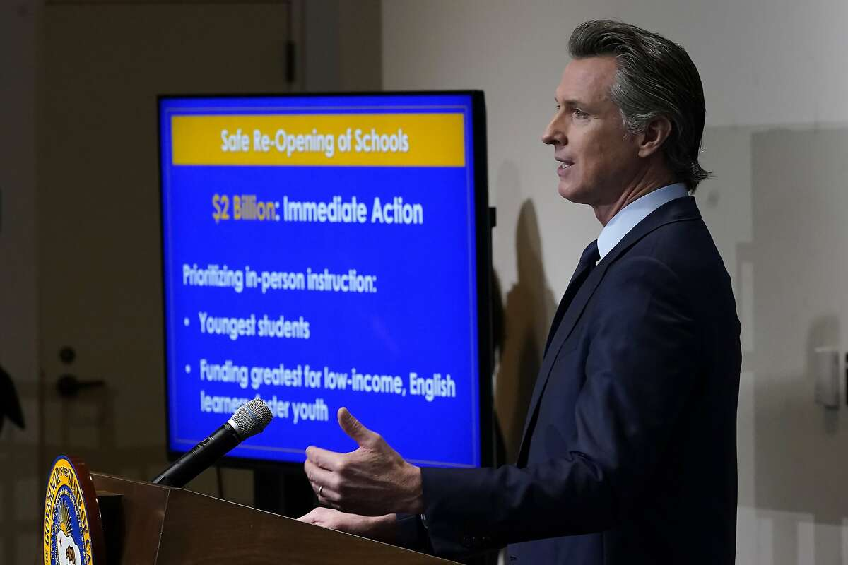 Gov. Gavin Newsom outlines his earlier plan for widespread reopening of schools at a Jan. 8 news conference in Sacramento. Newsom and legislative leaders have reached a new deal for returning some students to classrooms by the end of March.