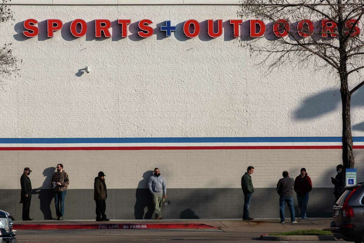 People wait outside of Academy located on Westheimer Rd. before the store opening, Friday, Jan. 29, 2021, in Houston.