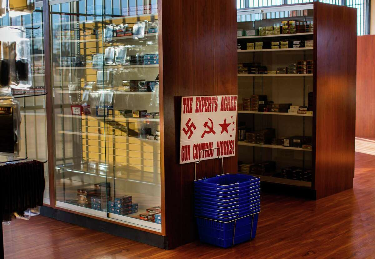 Shelves with stored bullets for sale at Collectors Firearms, Friday, Jan. 29, 2021, in Houston.
