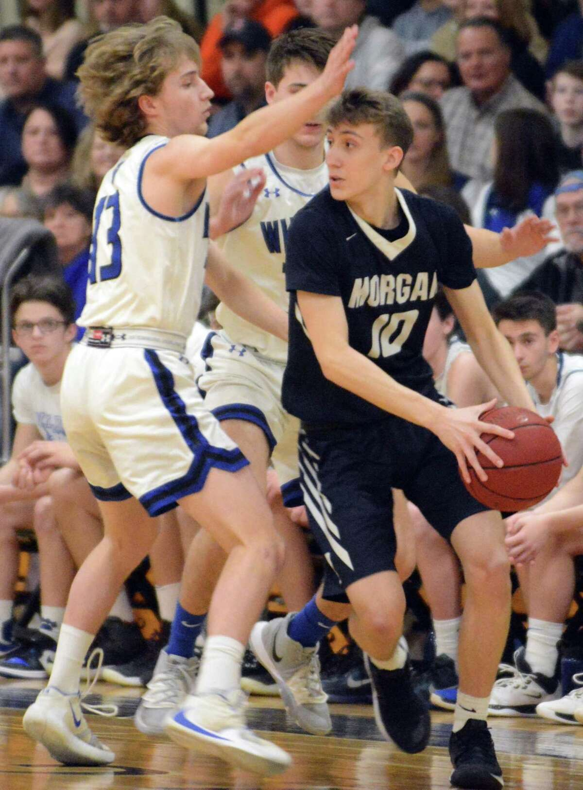 Morgan's Zach Johnson is defended by Old Lyme's Brady Sheffield.