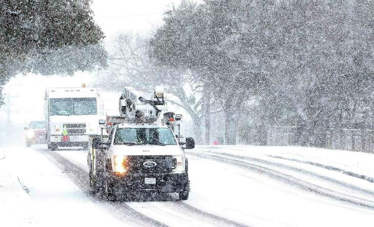 CPS Energy work crews were seen driving along Vance Jackson Road during another day of snow fall in San Antonio on Thursday, Feb 18, 2021.