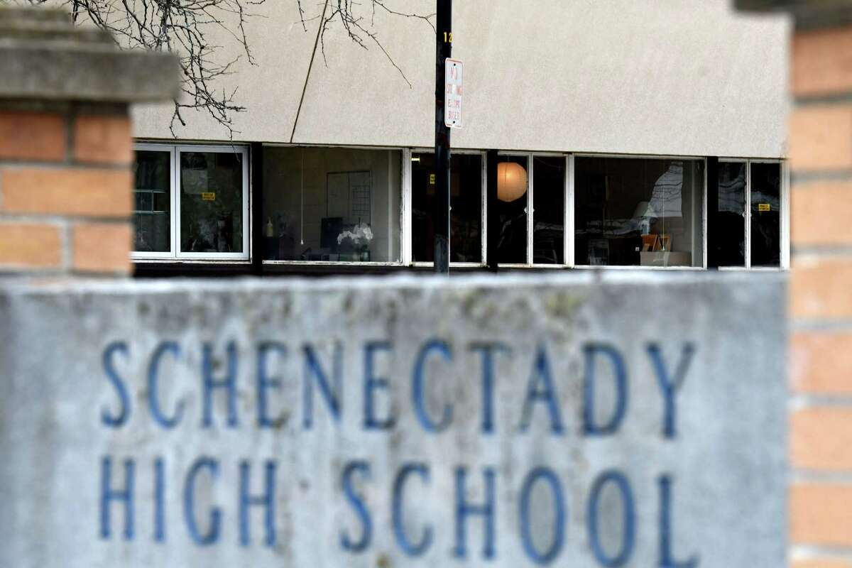 A few lights are visible in Schenectady High School as middle and high school students prepare for a Wednesday return to classrooms in the Schenectady School District on Monday, March 1, 2021, in Schenectady, N.Y. (Will Waldron/Times Union)
