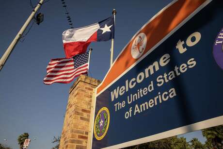 BROWNSVILLE, TEXAS - FEBRUARY 24: The U.S. and Texas flags fly near the U.S.-Mexico border on February 24, 2021 in Brownsville, Texas. (Photo by John Moore/Getty Images)