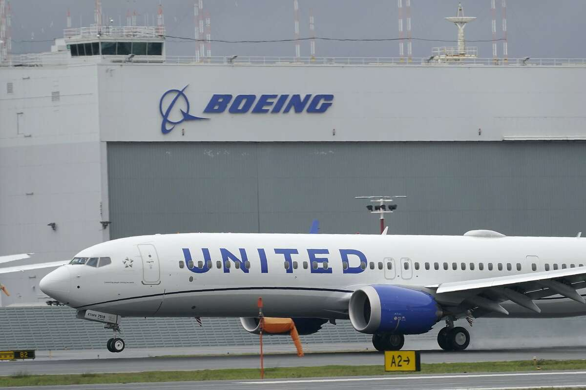 In this Nov. 18, 2020, file photo, a Boeing 737 Max 9 built for United Airlines lands at King County International Airport.