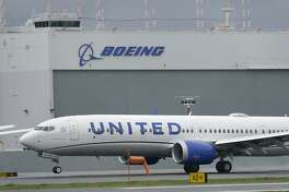 FILE - In this Nov. 18, 2020, file photo a Boeing 737 Max 9 built for United Airlines lands at King County International Airport - Boeing Field after a test flight from Moses Lake, Wash., in Seattle. United Airlines is expanding its order of Boeing 737 Max airplanes and taking some deliveries sooner as it ramps up for an anticipated increase in travel demand. Chief Operating Officer Andrew Nocella said in a memo on Monday, March 1, 2021, that the company placed an order for 25 new 737 Max aircraft for delivery in 2023. (AP Photo/Ted S. Warren, File)