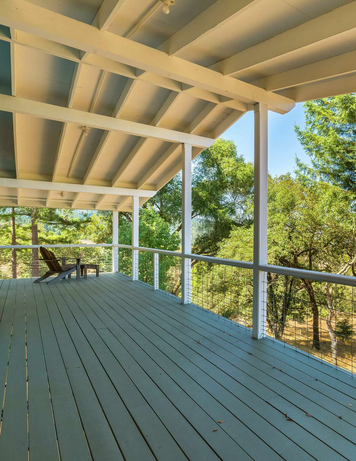 A covered porch stretches behind one of the two-bedroom houses at 16300 Highway 128 in Boonville.